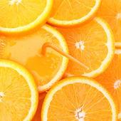 Stack of orange fruit slices with juice. — Stock Photo