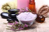 Bath salt, oil, towel and stones — Stock Photo