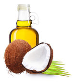 Coconut oil with palm leaves. — Stock Photo