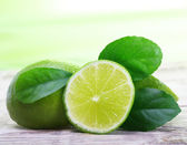 Green limes with leaves — Stock Photo