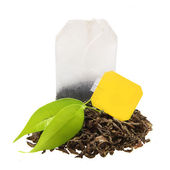 Tea bag with leaves isolated — Stock Photo