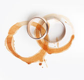 Two coffee stain and wedding rings — Stock Photo