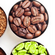 Bowls with green, roasted coffee beans, ground and instant coffee — Stock Photo