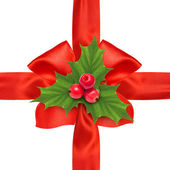 Red satin ribbon bow and holly berry sprig — Stockfoto