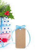 Gift boxes, holly berry and tag — Stock Photo