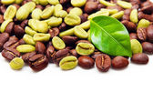 Green and black coffee beans. — Stock Photo