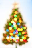 Abstract bokeh Christmas tree background. — Stock Photo