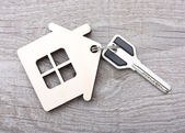Key with wooden house — Stock Photo