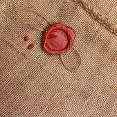 Burlap hessian sackingwith wax seal. — Stock Photo