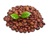 Black coffee beans, grain with leaf — Stock Photo