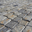 Cobblestone background in oblique perspective — Stock Photo