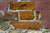 Fragment of old rad brick wall — Stock Photo