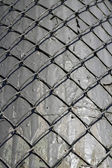 Metal grid on a gray background — Stock Photo