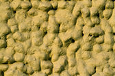 Yellow bumpy wall — Stockfoto