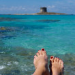 "Crystal water in mediterranean sea,woman""s feet with turquoise water background on summertime in Sardinia,Italy,Stintino beach photo with space for text — Stock Photo"