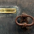 Very Old door handle and place for letters with old texture background — Stock Photo #28676739