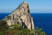 Rock formation in Sardinia, Italy.Pedra Lunga in Sardinia.Mediterranean coast.Rock with blue sky and crystal sea background,Sardinia nature with space for advertising text,summer in Sardinia,sardinian — Stock Photo