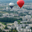 Stock Photo: Vilnius city from top, view to new suburbs, Europe, Vilnius, Lithuania. Vilnius city view. Vilnius city view with flying balloons background.Two balloons flying in air.Summer activities