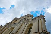Ilnius,Lithuania.Vilnius University (the oldest university in Baltic states and one of the oldest in Eastern Europe).Vilnius University from unusual composition.Old church in dramatic sky background — Стоковое фото