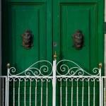 Green door in the city, details view, door fragment, maltese door, nice and bright contrast, exterior — Stock Photo #29419393
