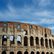 Colosseum in Rome, Italy on cloudy sky background. The Colosseum. Famous place. Cloudy blue nice sky background. — Stock Photo