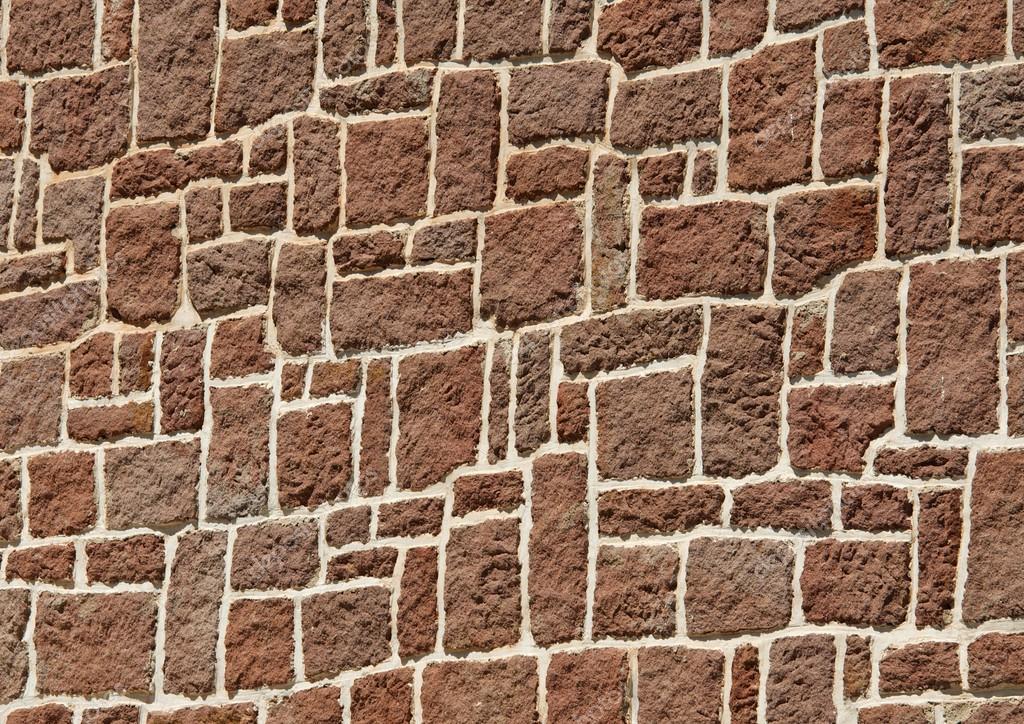 texture brune pierre chaude mur fond texture de morceaux de roche fond de mur en pierre gros. Black Bedroom Furniture Sets. Home Design Ideas