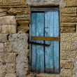 Stock Photo: Exterior,Old door fragment, old door texture view, abstract scene, nobody at home, weathered door, close door in bright wall background, colourful door, old object, destruction