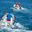 Stock Photo: Speed boat sailing in blue blur sebackground,speed boat close up, speed boat, water sport, speed boat close up with man.Saturated