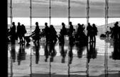 Shadows of people on building background, people shadows, artistic photo in black and white, B&W, selective focus.People shadows in departure hall in airport, abstract photo, unknown. Departure — Stock Photo