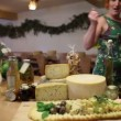 Stock Video: Family on trip trying served cheeses
