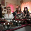 Stock Video: Sexy young women making chocolate pralines