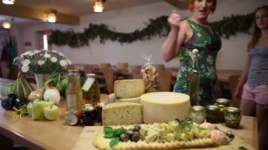 Family on a trip trying served cheeses — Stock Video