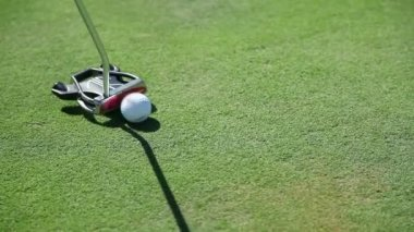 Close up shot of a golf club that hits the golf ball straight to the hall — Stock Video