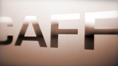 Close up of text 'Caffee' with camera movement — Stock Video