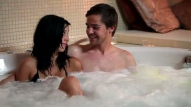 Couple kissing in a jacuzzi — Stock Video