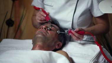 Shot of a special facial care for a middle aged man — Stock Video