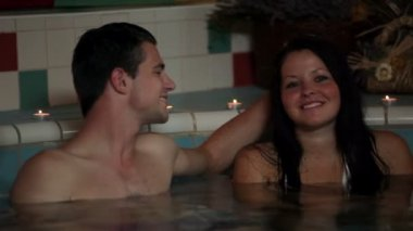 Family in a pool — Stockvideo