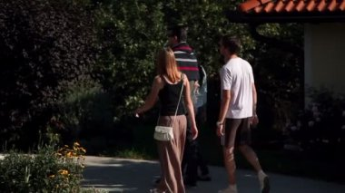 Two young couples sightseeing in beautiful countryside — Stock Video