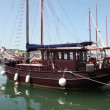 Stock Video: Shoot of old wooden boat parked in marine