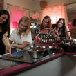 Stock Video: Four young women preparing chocolate candy