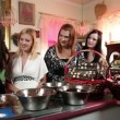 Stock Video: Shot of four girlfriends having good time while making chocolate