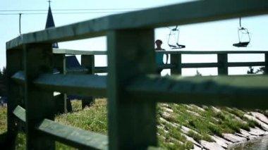 Young woman jogging near lake — Stock Video