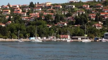 Shot of the shore neare Piran taken from the moving boat. — Stock Video