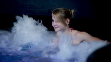 Young beautiful woman in hot tub — Stock Video