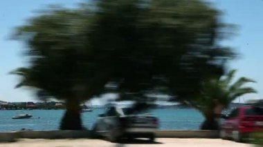Shot of the adriatic coast, taken from a driving car. — Stock video