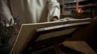 Close up of a monk reading old book — Vídeo stock