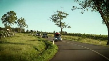 Cars driving through a beautiful landscape — Stockvideo