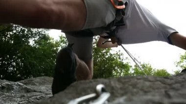 Young man rock climbing in nature near forest — Stock Video