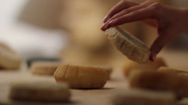 Close up of woman's hand putting small cheeses together — 图库视频影像