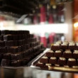 Stock Video: Shot of chocolate prlaines in showcase